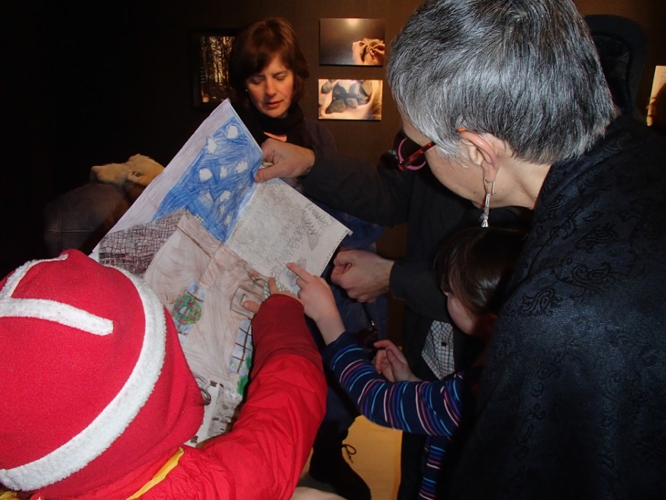 Isadora Tutter points to Zeleny Les drawing details